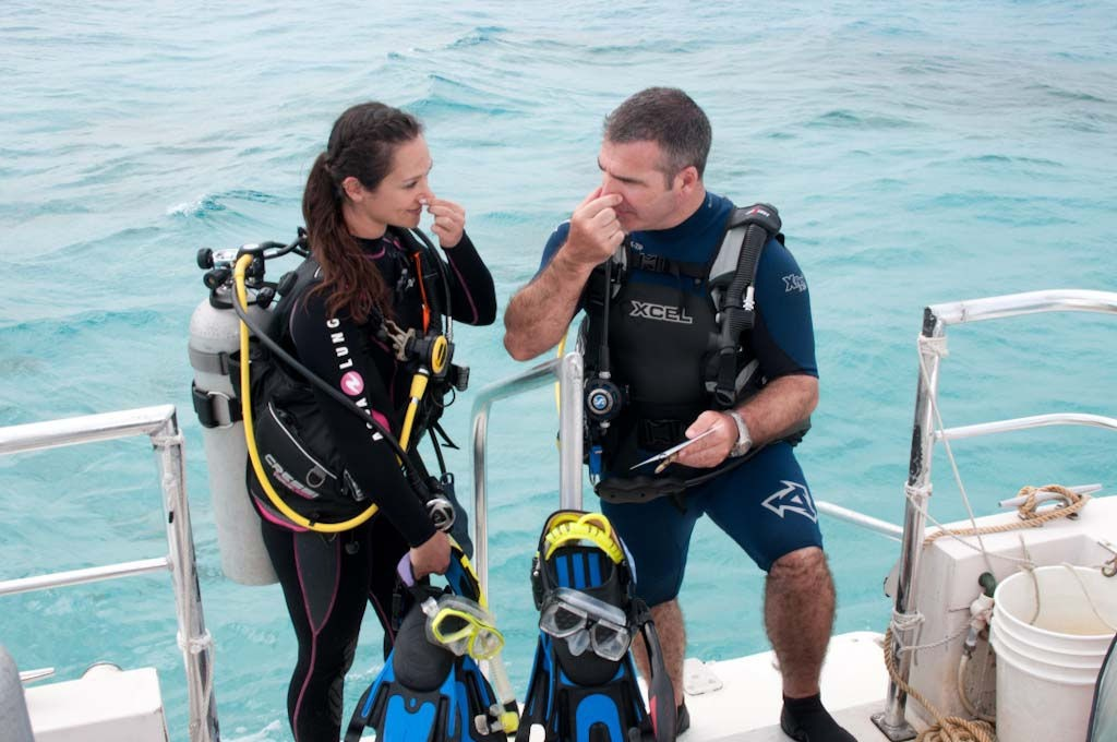 Scuba Divers equalizing prior to a dive