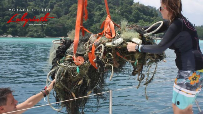 Hoisting collected debris onto the yacht