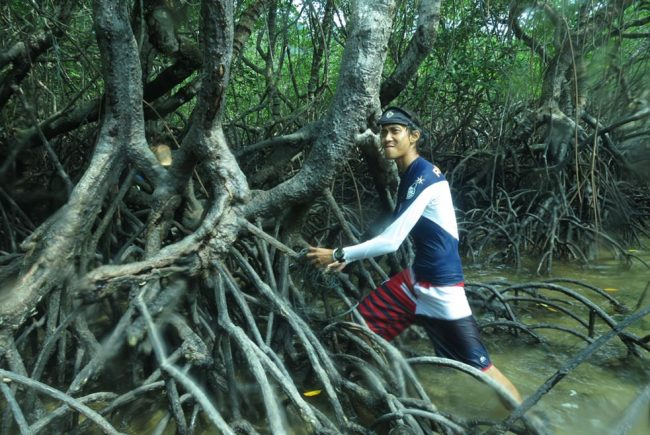Emir contemplating the effects of all this rope strangling the mangrove roots