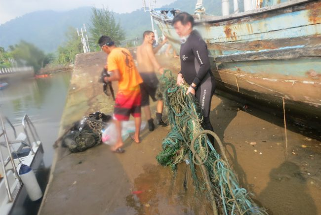 Dragging the haul up Tekek jetty for responsible disposal